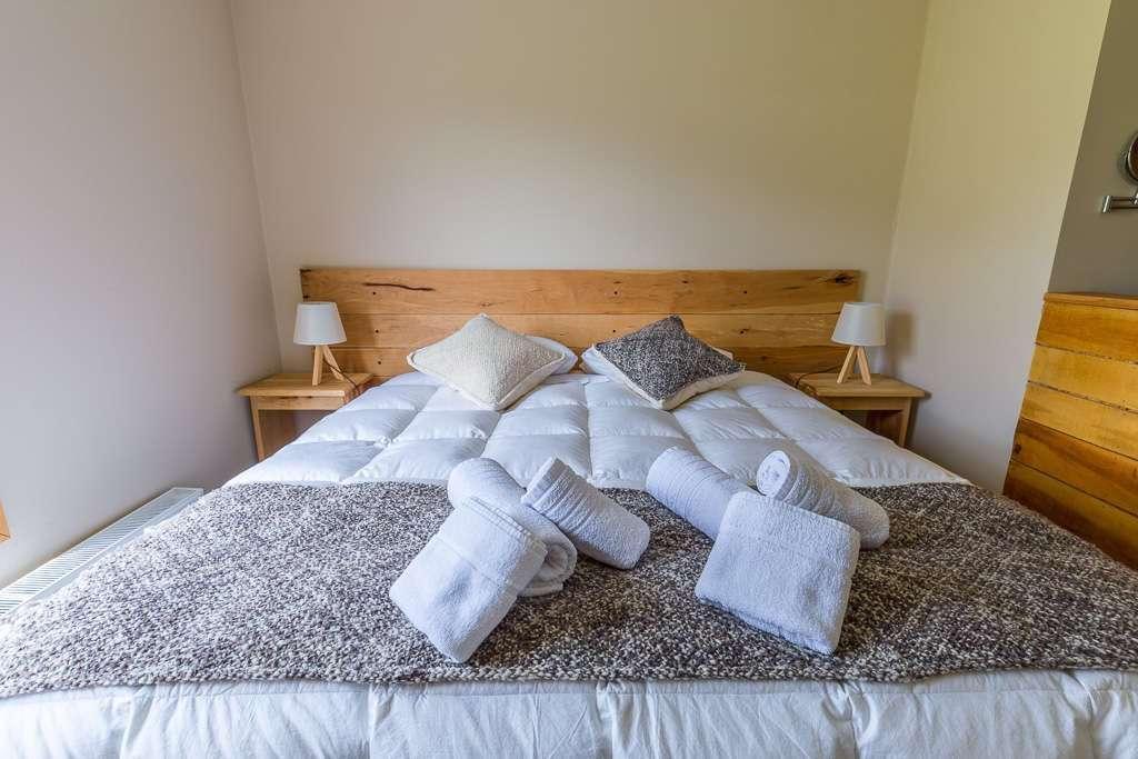 Cama de la habitación en el hostal el Puestero, Puerto Natales