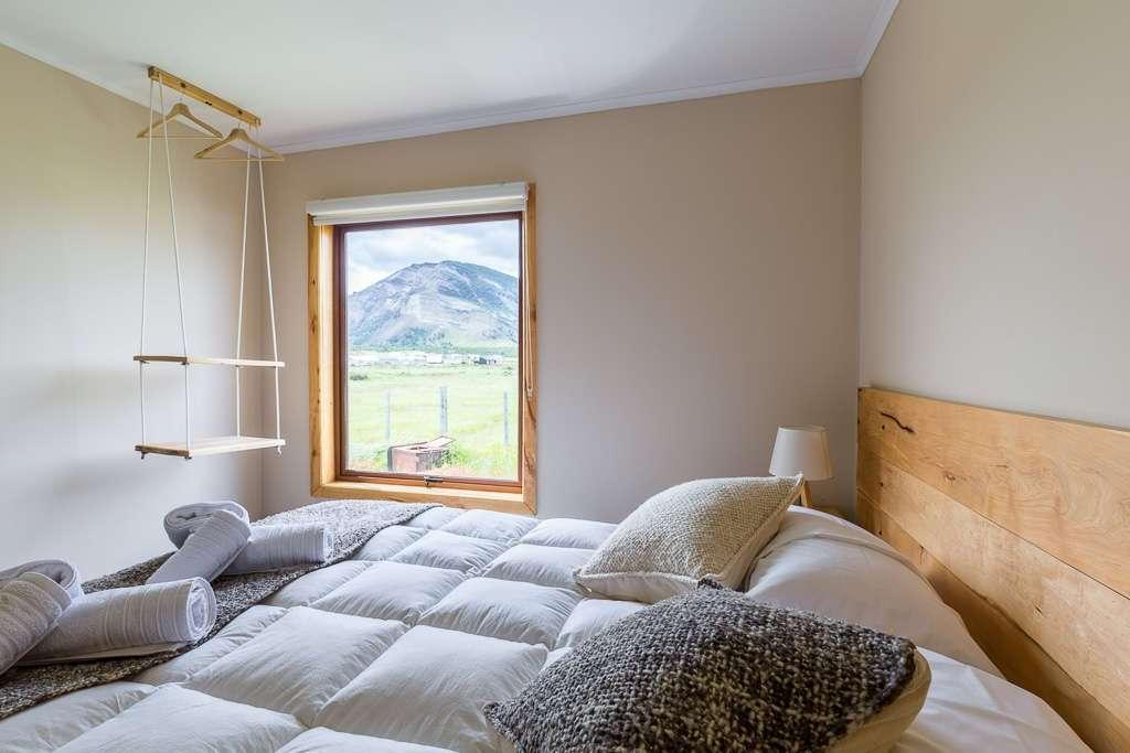 Vistas desde la cama en el hostal el Puestero, Puerto Natales